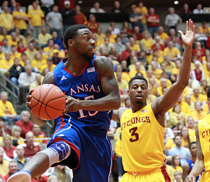 Elijah Jonhson scores a career-high 39 points to help coach Bill Self reach the 500-win milestone. (USATSI)