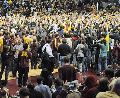 Minnesota fans storm the court after their Gophers stun the Hoosiers and solidify their case for the NCAA tourney. (USATSI)