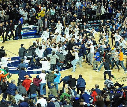 Penn State fans rush the court after the Nittany Lions upset the Wolverines for their first Big Ten victory. (USATSI)