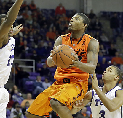 TCU has no answer for Marcus Smart, who puts up a career-high 28 points for Oklahoma State. (AP)