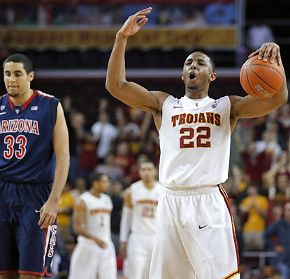 Byron Wesley (18 points) is one of five Trojans to reach double figures in the upset over Arizona. (AP)