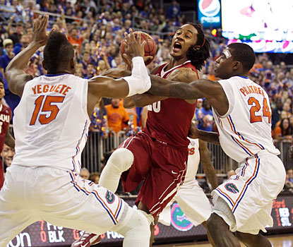 Casey Prather (24) leads the way as the Gators clamp down on defense in the second half.  (USATSI)