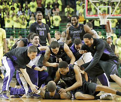 Rodney McGruder is mauled by teammates after he sinks the winning 3 at the buzzer. (AP)