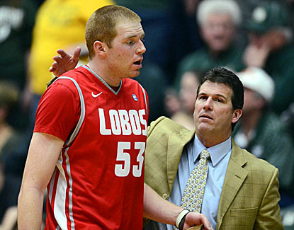 Alex Kirk, who scores 15 points with nine rebounds, shares a moment with coach Steve Alford. (USATSI)
