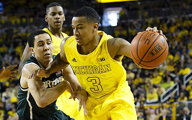 Trey Burke torches Michigan State for 21 points and 8 assists in the Wolverines' 58-57 win. (USATSI)