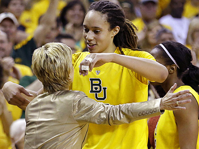 Baylor's Brittney Griner (right) hugs her coach, Kim Mulkey, as she leaves the game. (AP)