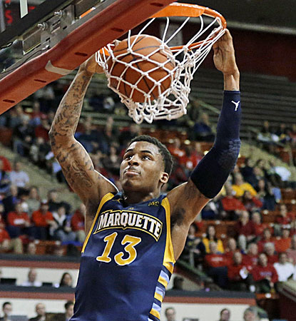 Marquette's Vander Blue scores 22 points and later hits the game-clinching free throws. (AP)