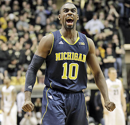 Tim Hardaway Jr. scores 16 points, including a crucial 3-pointer to put Michigan up 66-64 with 3:46 left. (AP)