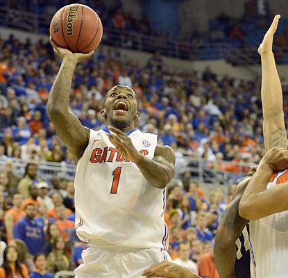 Kenny Boynton puts up a team-high 15 points to help the Gators win their fourth outright league title. (AP)