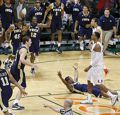 Marcus Georges-Hunt (floor) and the visiting Yellow Jackets prevent the Canes from clinching the outright ACC title. (USATSI)