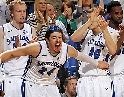 Saint Louis players take in the final moments of the Billikens' win over La Salle, clinching a share of the Atlantic 10 title. (AP)