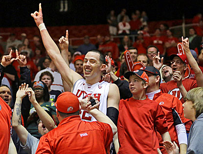 Jason Washburn celebrates with Utes fans after scoring 20 points and grabbing 13 rebounds in Utah's win over Oregon. (AP)