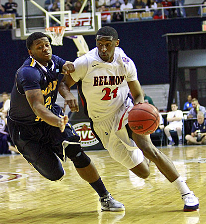 Belmont's Ian Clark (right), who scores 11 points, drives against Murray State guard Dexter Fields. (AP)