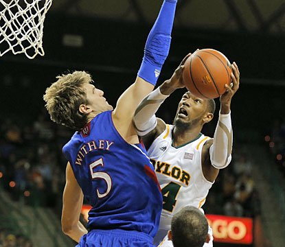Cory Jefferson puts up 25 points against fourth-ranked Kansas, helping Baylor's cause for a berth in the NCAA tournament. (AP)