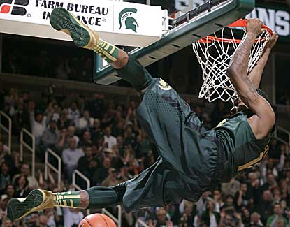Keith Appling dunks for two of his team-high 16 points in Michigan State's win over Northwestern. (AP)