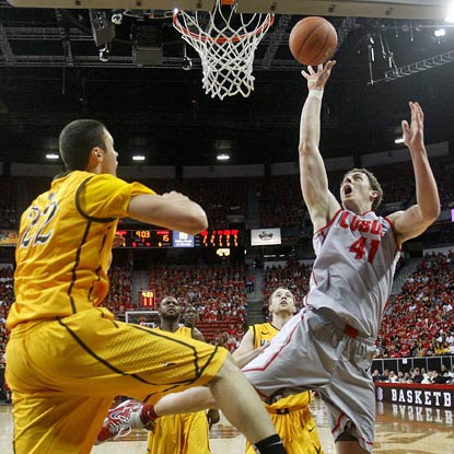 New Mexico's Cameron Bairstow (right) puts up 14 points and eight rebounds to help the Lobos advance.  (AP)