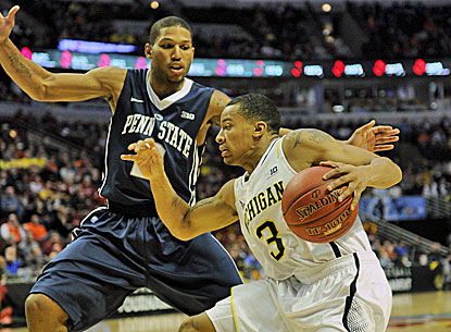 Michigan's Trey Burke (right) tries to get by Penn State's D.J. Newbill as he scores 21 points in the win.  (USATSI)
