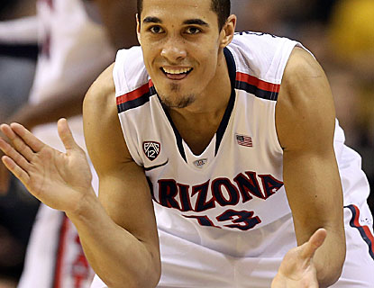 Nick Johnson scores 18 points, including a contested shot with 34 seconds left to lift Arizona. (Getty Images)