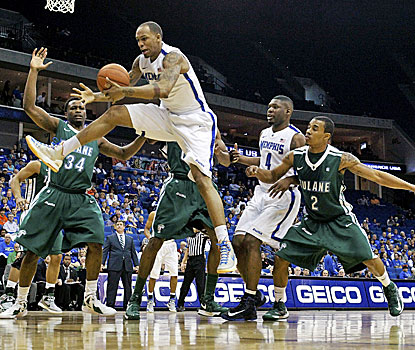 Memphis' Ferrakohn Hall (right) grabs a rebound in front of Tulane's Tre Drye as the Tigers cruise to a 81-68 win. (AP)