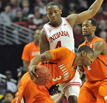 Indiana's Victor Oladipo scores 12, grabs 11 rebounds and steps up on defense vs. Illinois star Brandon Paul.  (USATSI)