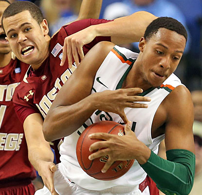 Kenny Kadji contributes 15 points to help top-seeded Miami fight off the upset bid from Boston College.  (Getty Images)