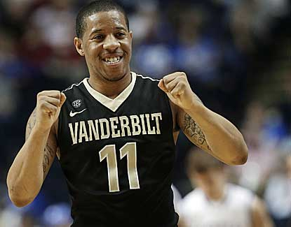 Vanderbilt guard Kyle Fuller starts the celebration as the Commodores knock off No. 2 seed Kentucky at the SEC tournament. (AP)