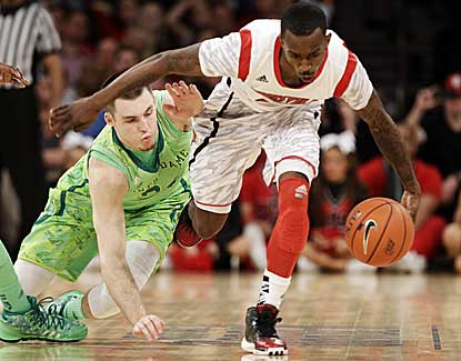 Russ Smith scores a game-high 20 points to lead Louisville past Notre Dame and into the Big East title game. (AP)