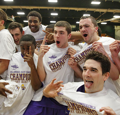 Albany celebrates its first America East tournament title since winning back-to-back crowns in 2006 and '07.  (USATSI)