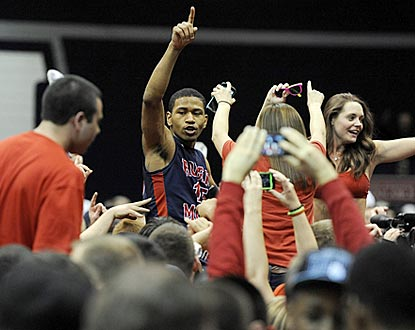 Karvel Anderson gets a hero's sendoff from Robert Morris revelers after the Colonials topple Kentucky.  (AP)