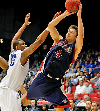 Matthew Dellavedova, who scores 22 points in the Gaels' First Four win, shoots over Middle Tennessee's Shawn Jones.  (Getty Images)
