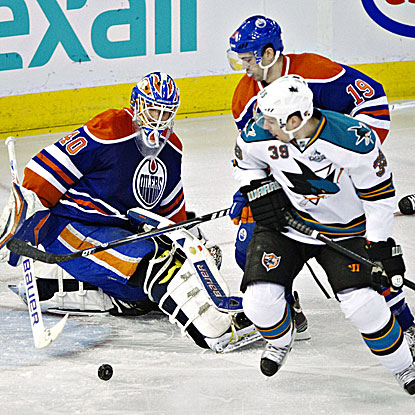 Logan Couture (right) scores twice in regulation and adds a shootout goal againstg the Oilers. (AP)