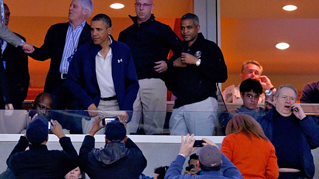 President Obama gets a lot of attention as he makes his way to his suite seat. (Getty Images)
