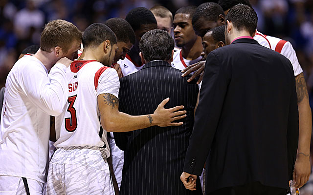 Louisville players huddle after losing Kevin Ware to a broken leg in the first half against Duke. (Getty Images)