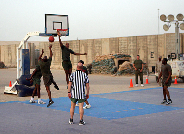 Going for the block, Brooks plays hoops with other Marines at Camp Al Taqaddum. (Courtesy of Robert Brooks)