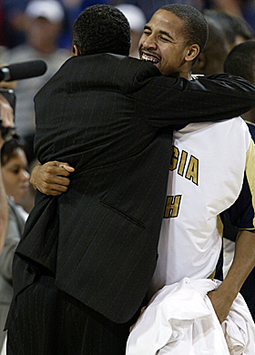 Brooks hugs coach Paul Hewitt after Ga. Tech beats KU to make the 2004 Final Four. (Getty Images)