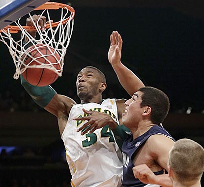 Baylor's Cory Jefferson dunks past Brigham Young's Bronson Kaufusi during the opening half.  (AP)