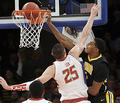 Iowa power forward Melsahn Basabe throws one down over Maryland's Alex Len during the first half.  (AP)