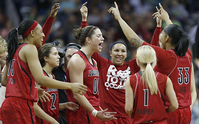 Sara Hammond (00) exults as her teammates celebrate Louisville's berth in the NCAA title game. (USATSI)
