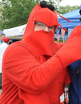The man in the mask: Slessinger isn't beyond dressing up as a crawfish. (UNO Athletics)
