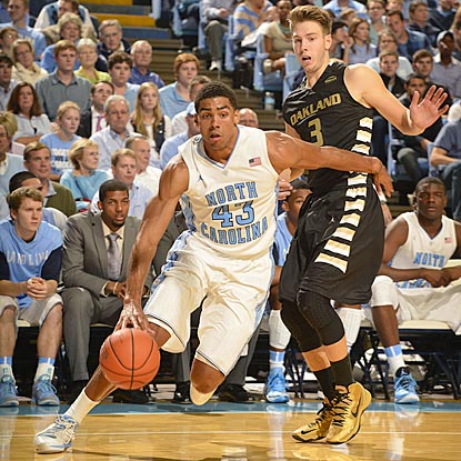 North Carolina's James Michael McAdoo drives around Oakland's Travis Bader during the second half.  (USATSI)