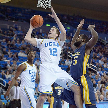 UCLA's David Wear attempts to shoot while Drexel's Dartaye Ruffin defends. Wear winds up with 14 points on 6-of-11 shooting.  (USATSI)