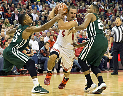 Aaron Craft, who scores 17 points for the Buckeyes, tries to split a pair of Ohio defenders. (USATSI)