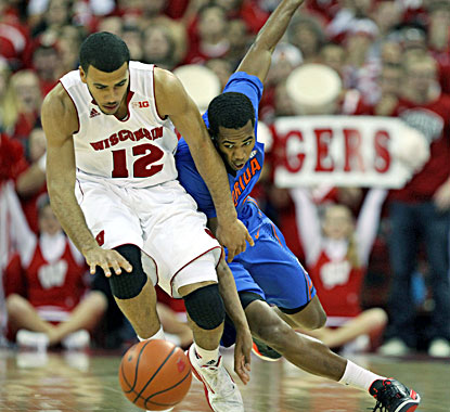 Wisconsin's Traevon Jackson (left), who scores 13 points, beats Florida's Kasey Hill to the ball in the Badgers' win. (USATSI)