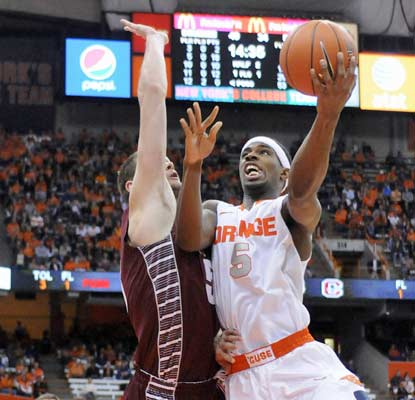 C.J. Fair has 20 points and the ninth-ranked Orange win their 48th straight game against Colgate.  (USATSI)
