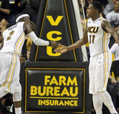 VCU's Briante Weber (left) and Rob Brandenberg finally wear down a tough Winthrop squad on Saturday night.   (USATSI)