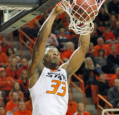 OK State's Marcus Smart surpasses his previous career-high of 28 points with a 36-point night against No. 11 Memphis. (USATSI)