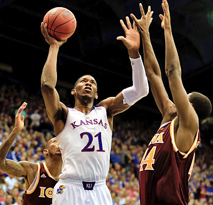 Kansas' 7-foot freshman Joel Embiid enjoys a breakout performance with 16 points and 13 rebounds against Iona. (Getty Images)