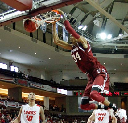Raphiael Putney slams home two of his 18 points as UMass upends the 19th-ranked Lobos in Charleston.  (USATSI)