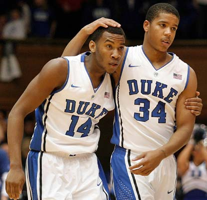 Rasheed Sulaimon (14) and Andre Dawkins barely hold off Vermont to extend Duke's nonconference home streak to 106.  (USATSI)