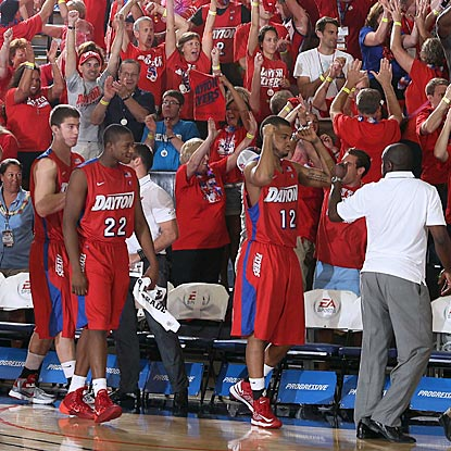 Four thousand miles from Dayton, Flyers fans celebrate as their team walks off the court with an unexpected victory.  (USATSI)